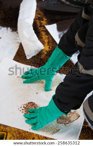 oil spill cleanup on working area. danger for the nature. - stock photo