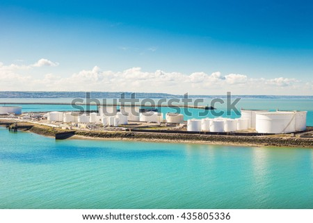 Oil Storage deep water port and blue sky. - stock photo