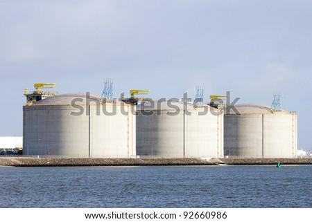 Oil storage tanks in the Rotterdam harbor - stock photo