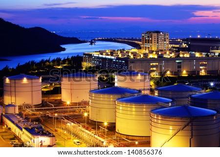 Oil tank in cargo terminal - stock photo