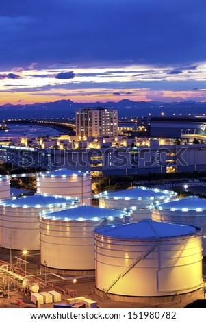 Oil tank in cargo terminal - stock photo