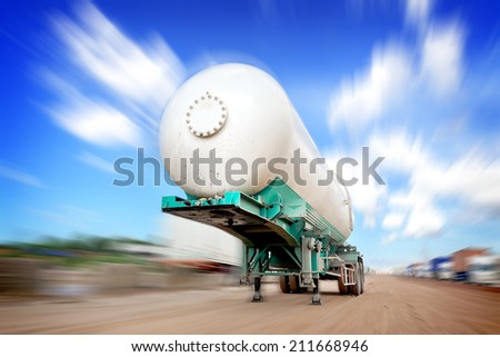 Oil tank truck at construction site - stock photo