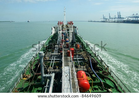 oil tanker is moving to the port - stock photo