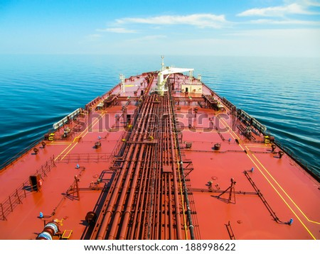 Oil tanker is proceeding in blue ocean under cloudy sky - stock photo - stock photo