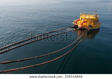 Oil tanker is transferring oil to the cargo vessel - stock photo