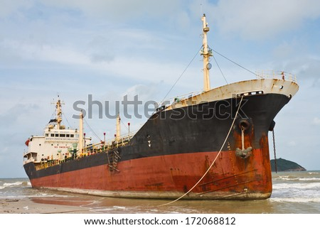 Oil Tanker Ship on the beach - stock photo