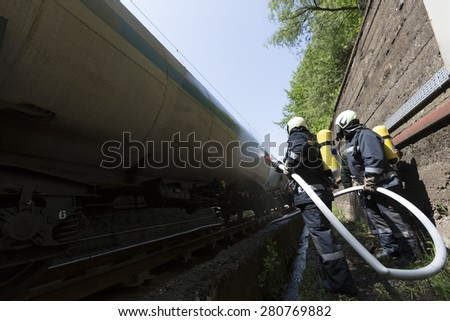 Oil tanker train near Sofia, Bulgaria. Fire safety and civil protection service at Fire department is training in a train crash with spilled toxic and flammable materials from the cargo tanks. - stock photo
