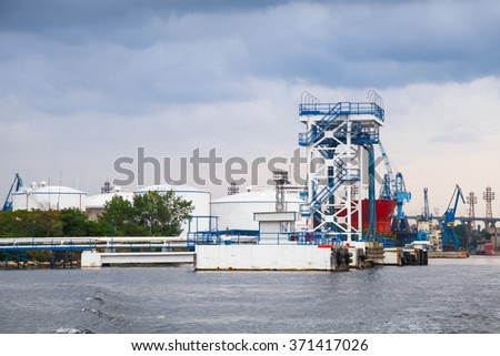 Oil terminal with equipment for tankers loading on Black sea coast in Varna port, Bulgaria - stock photo