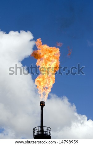 Oil torch in West Siberia. Pollution of environment