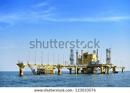 Oil transfer station on big sea - stock photo