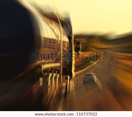 oil truck on a highway in motion - stock photo