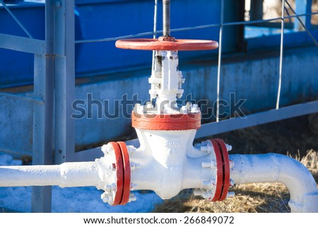 Oil valve and pipe - stock photo