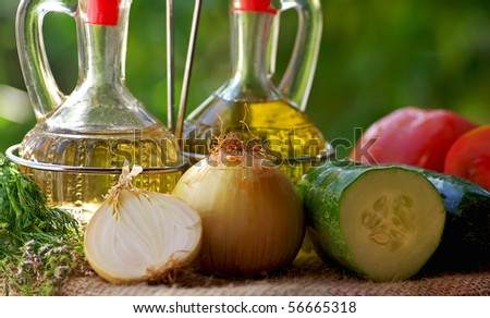 Oil vinegar and vegetables. - stock photo