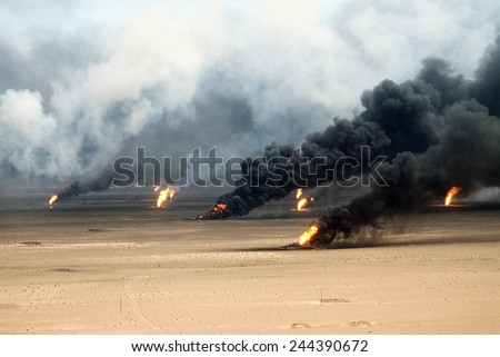 Oil well fires rage outside Kuwait City in the aftermath of the First Gulf War. Retreating Iraqi troops set fire to Kuwait's oil fields. Mar. 21 1991. - stock photo