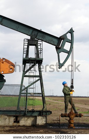 oil worker check pumpjack