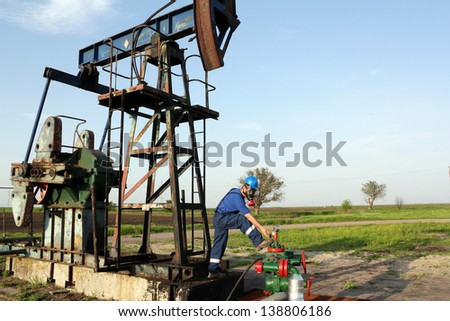 oil worker with gas mask check pipeline - stock photo