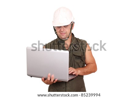 oil worker with laptop - stock photo