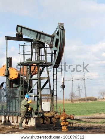 oil worker with thumb up - stock photo