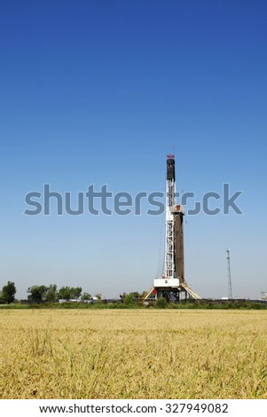 Oilfield derrick and paddy fields