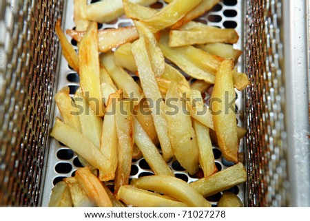 oily fried potatoes in the fryer junk food