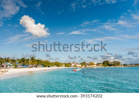 OISTINS, BARBADOS - MARCH 15, 2014: Miami Beach Landscape with Ocean Water Blue Sky