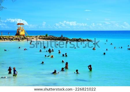 OISTINS, BARBADOS, OCTOBER 19, 2014. public beach scenery, oistins, barbados, October 19, 2014 - stock photo