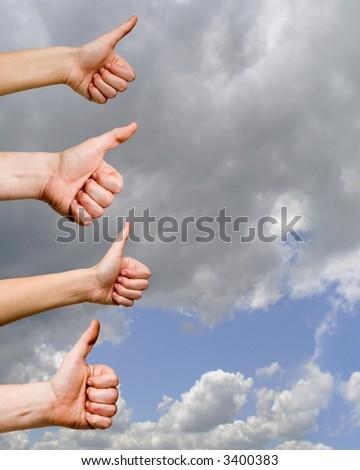 OK gestures against a blue sky - stock photo