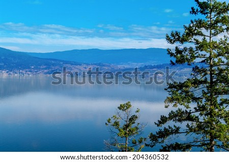 Okanagan Lake and Surrounding hills from the western shore - stock photo