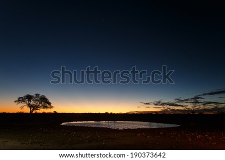 Okaukuejo Water Hole in Etosha National Park in Nambia, Africa - stock photo