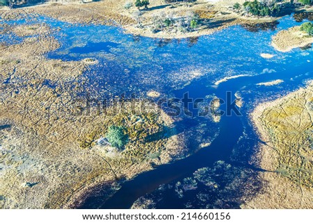 Okavango delta (or Okavango Grassland) is one of the Seven Natural Wonders of Africa (view from the airplane) - Botswana - stock photo