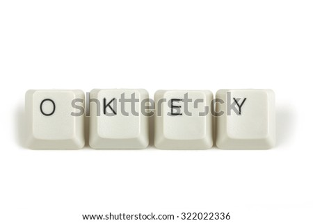 okey text from scattered keyboard keys isolated on white background