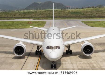 OKINAWA, JAPAN - AUG. 16, 2015: Boeing 787-8 taxing at the New Ishigaki International Airport in Okinawa, Japan. - stock photo