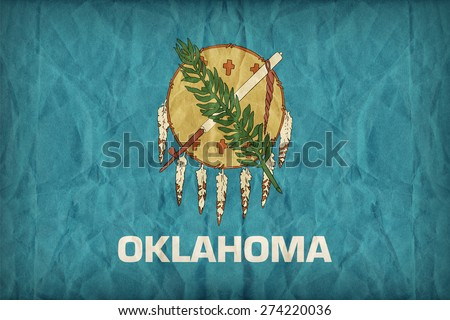 Oklahoma flag on paper texture,retro vintage style - stock photo