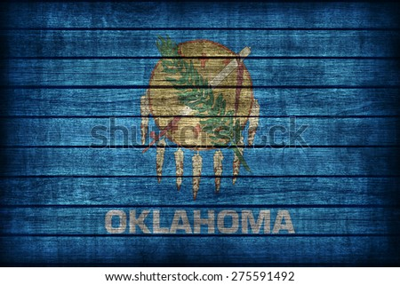 Oklahoma flag pattern on wooden board texture ,retro vintage style - stock photo