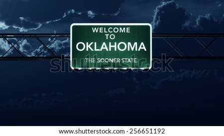 Oklahoma USA State Welcome to Interstate Highway Road Sign at Night - stock photo