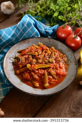 Okra dish with tomatoes (Traditional greek, romanian, bulgarian and turkish dish) - stock photo