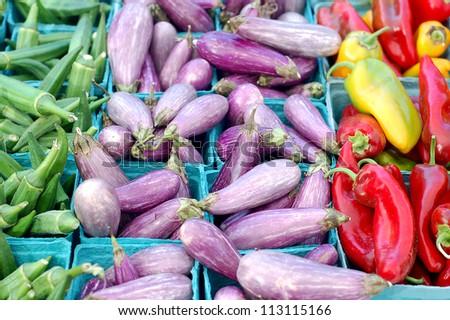 okra, eggplant, pepper in farmer market place - stock photo