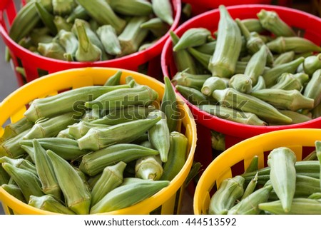 Okra for sale in colorful baskets at farmers market in Asheville North Carolina