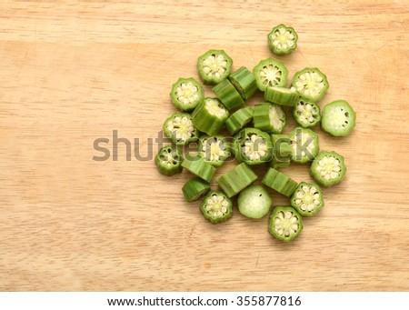 Okra on wooden background - stock photo