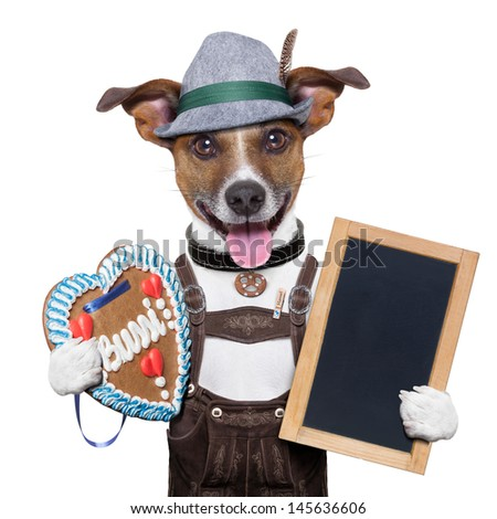 oktoberfest dog with blackboard and gingerbread heart, smiling happy - stock photo