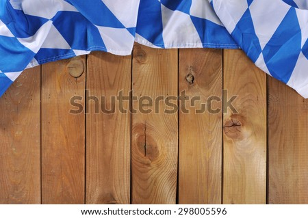 Oktoberfest in Germany - original Bavarian flag on old weathered wooden board. Background with copyspace. - stock photo