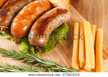 ... menu, chicken sausage, cheese and rosemary. Wooden background