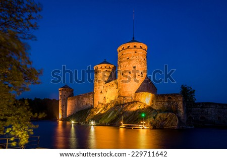 Olavinlinna fortress at night with bright illumination. Savonlinna, Finland. - stock photo
