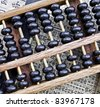 old abacus on  text - stock photo