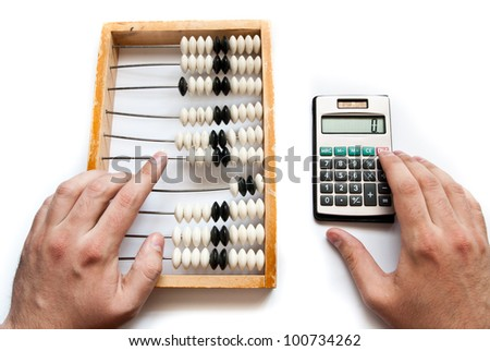 old abacus with calculator and hands - stock photo
