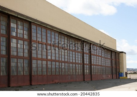 Old abandoned airplane hangar with doors shut