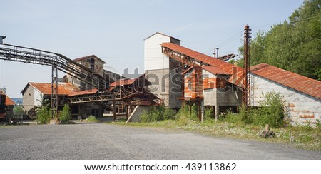 Old abandoned and useless factory building - stock photo
