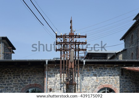 Old abandoned and useless factory building, electrical installation at an abandoned factory - stock photo