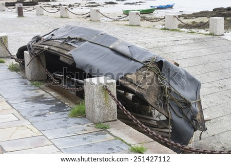 old abandoned boat on the beach - stock photo