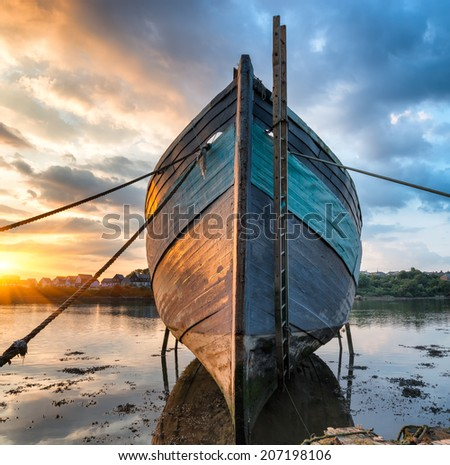 Old abandoned boat on the shore - stock photo